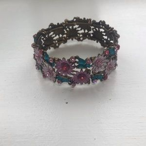Gold, pink, and blue flowery bracelet.